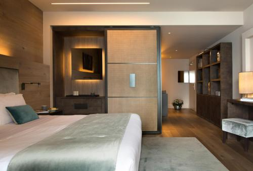 A bed or beds in a room at Filario Hotel & Residences