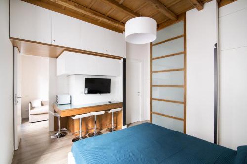 Uma TV ou centro de entretenimento em Domenichino Luxury Home