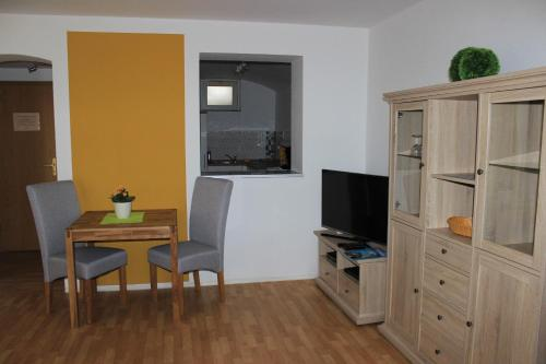 A television and/or entertainment center at APARTHOTEL 1A