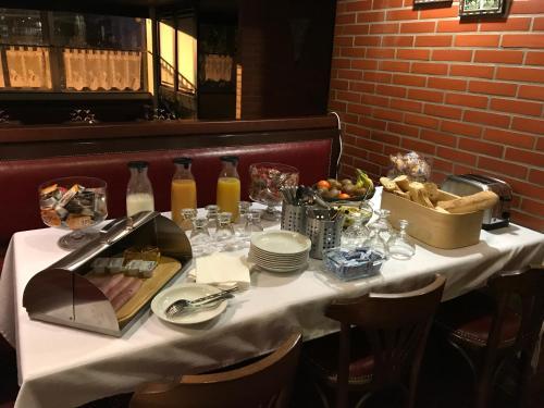 Restaurant ou autre lieu de restauration dans l'établissement Firmhotel
