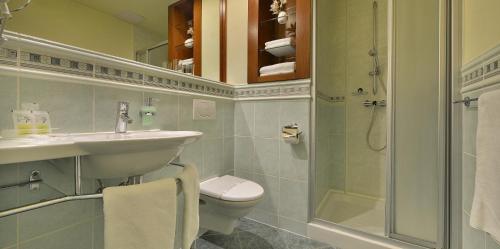 Koupelna v ubytování Wellness Hotel Happy Star