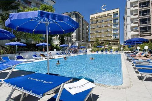 The swimming pool at or near Hotel Caravelle
