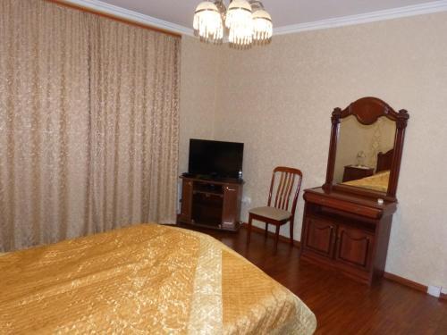 Телевизор и/или развлекательный центр в Апартаменты Adrimi
