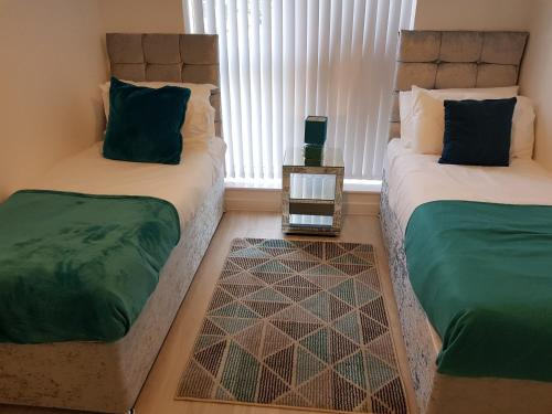 A bed or beds in a room at Vetrelax Blake Lodge