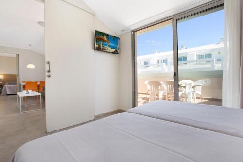 Een bed of bedden in een kamer bij Odissea Park