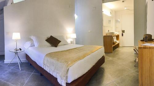 Cama o camas de una habitación en Hotel Secrets Priorat