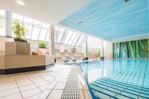 The swimming pool at or near Best Western Plus Hotel Am Schlossberg