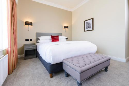 A bed or beds in a room at The Metropole Hotel Cork