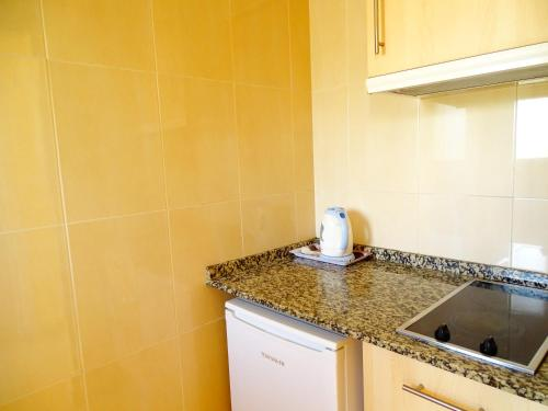 A kitchen or kitchenette at Rex Apartment