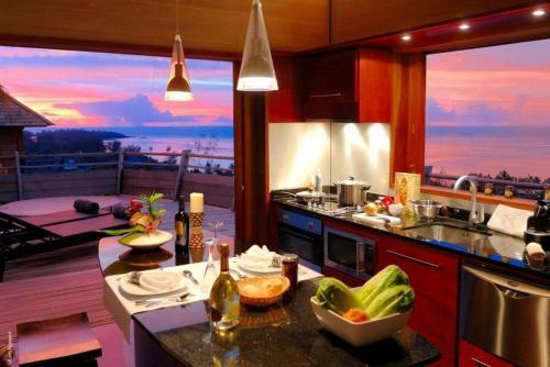 Um restaurante ou outro lugar para comer em MOOREA - Villa Fetia