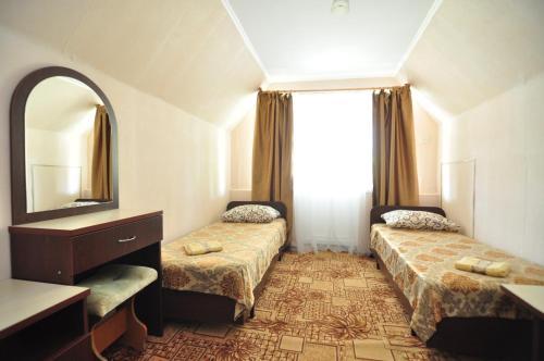 Кровать или кровати в номере Гостевой Дом Кристель