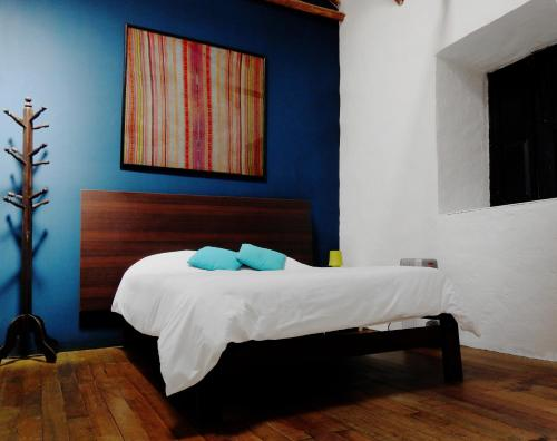 A bed or beds in a room at Intro Hostels Cusco