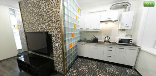 Кухня или мини-кухня в Апартаменты Amazing Studio