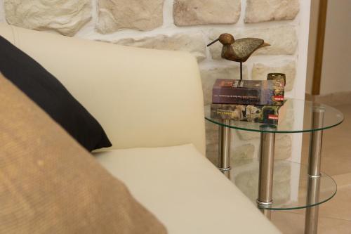 A bed or beds in a room at Villa Mediterranea - Garden Suite
