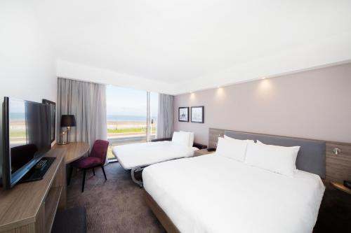 A bed or beds in a room at Hampton By Hilton Blackpool