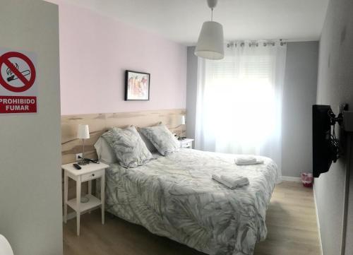 A bed or beds in a room at Alojamientos Olga