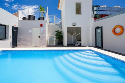 The swimming pool at or near Exe Málaga Museos