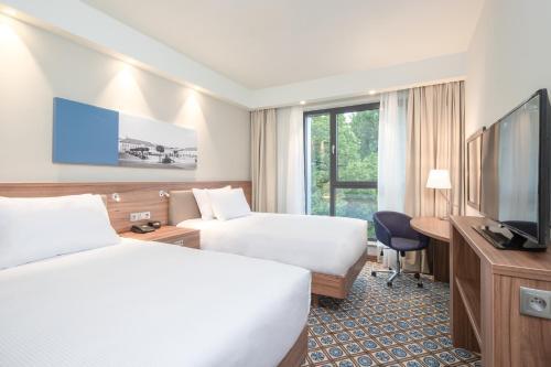 Un ou plusieurs lits dans un hébergement de l'établissement Hampton by Hilton Oswiecim