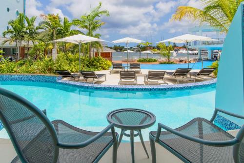 The swimming pool at or close to Harbor Club St Lucia, Curio Collection by Hilton