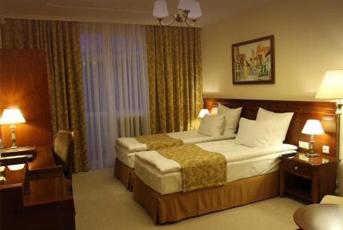 Кровать или кровати в номере Отель Вейлер