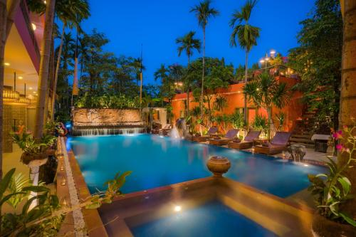 The swimming pool at or near Golden Temple Hotel