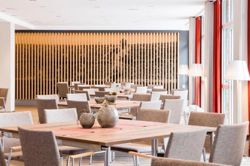 Ein Restaurant oder anderes Speiselokal in der Unterkunft K6 Seminarhotel