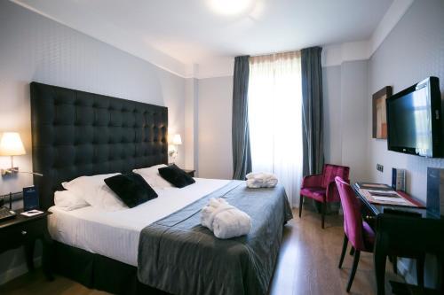 A bed or beds in a room at La Casa de la Trinidad