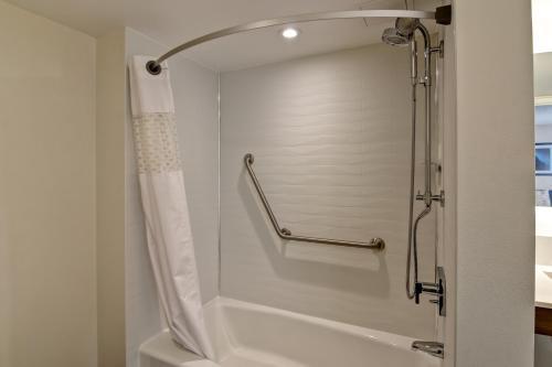 A bathroom at Hampton Inn & Suites by Hilton Calgary-Airport