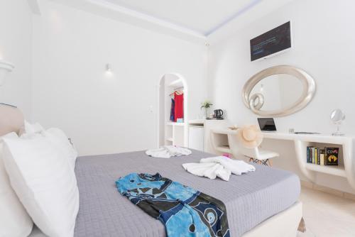 Un ou plusieurs lits dans un hébergement de l'établissement Anezina Villas