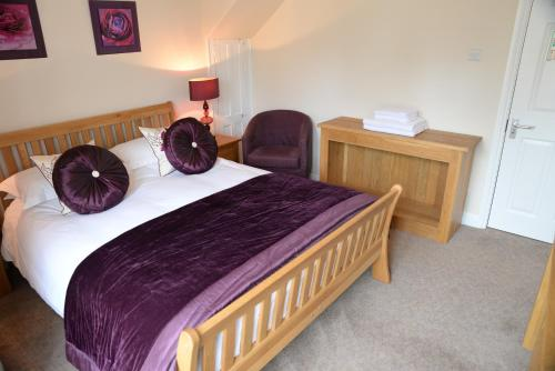 A bed or beds in a room at The Foresters
