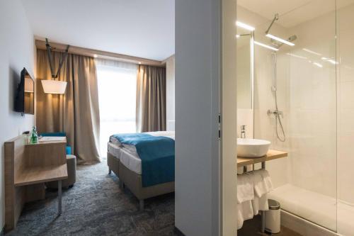A bathroom at Das Alfred