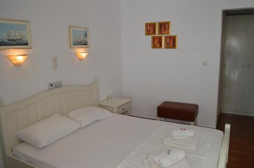 Ένα ή περισσότερα κρεβάτια σε δωμάτιο στο Διαμερίσματα της Αγγελικής