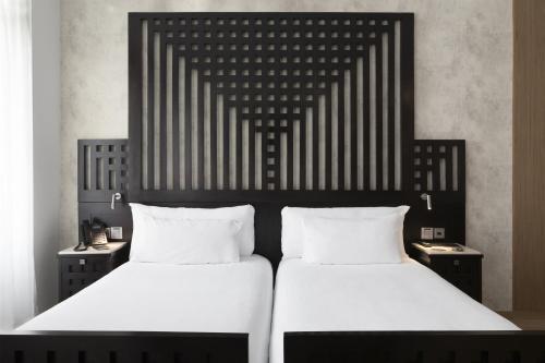 Un ou plusieurs lits dans un hébergement de l'établissement ICON Casona 1900