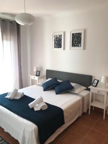 A bed or beds in a room at Apartamento POR DO SOL