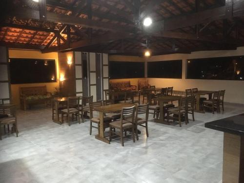 A restaurant or other place to eat at Pousada Circuito das Águas