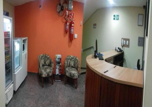 Лобби или стойка регистрации в Quality Leste Hotel