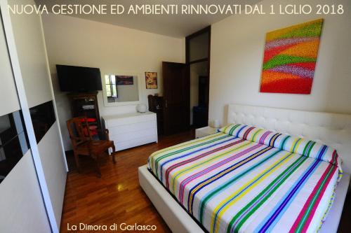 Letto o letti in una camera di La Dimora Di Garlasco Bed & Breakfast - Soggiorno e Cena