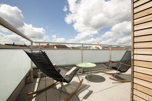 A balcony or terrace at James Boutique Hôtel Colmar centre