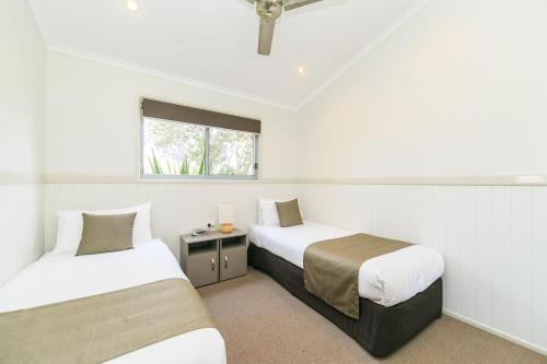 A bed or beds in a room at Reflections Holiday Parks Lennox Head