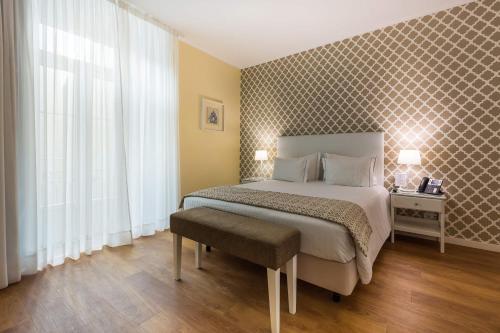 Cama ou camas em um quarto em Dream Chiado Apartments