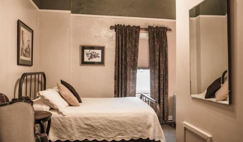 A bed or beds in a room at Weatherford Hotel