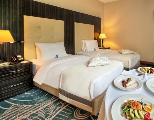 Кровать или кровати в номере Crowne Plaza - Borjomi, an IHG Hotel