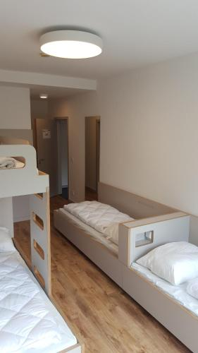 A bed or beds in a room at Jugendherberge-Berlin-International
