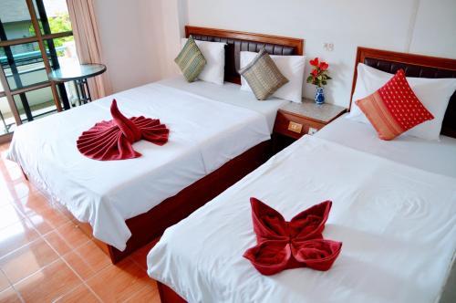 Ein Bett oder Betten in einem Zimmer der Unterkunft Bonny Hotel