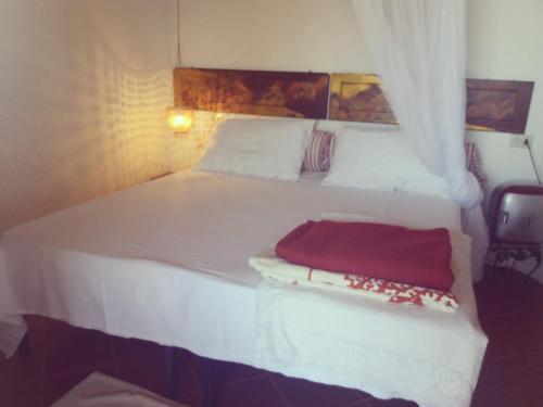 A bed or beds in a room at Villa La Cuata