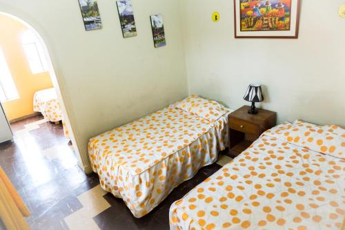 A bed or beds in a room at Friendly AQP Hostel
