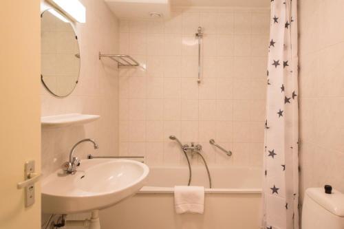 Ein Badezimmer in der Unterkunft Kaap appartementen
