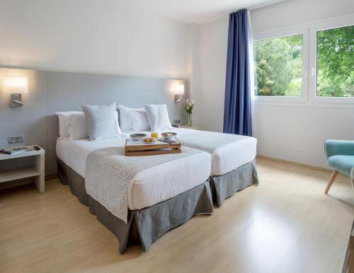 A bed or beds in a room at Augusta Barcelona Vallès