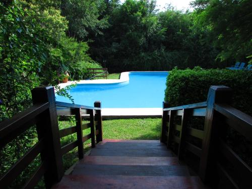 A view of the pool at Cabañas Mirasoles or nearby