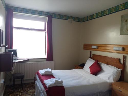Cama o camas de una habitación en Anno Santo Hotel